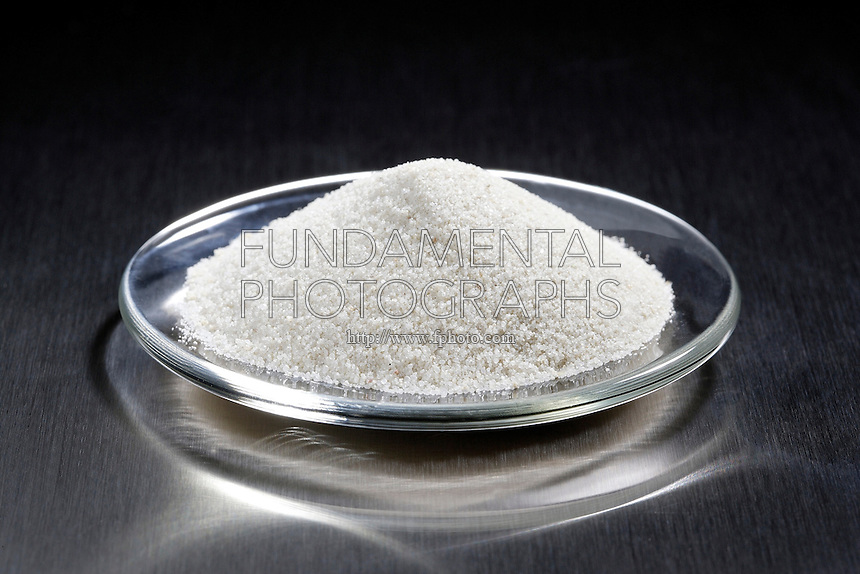 SAND IN A WATCHGLASS<br /> (Variations Available)<br /> White Sand Sample- Almost Pure Silicon Dioxide<br /> <br /> Sand is a naturally occurring granular material comprised of finely divided rock and mineral particles. The most common constituent of this sample is SiO2 in quartz form.