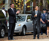 United States President Barack Obama jokes with reporters during a walk with White House Travel Director Marvin Nicholson (left) back to the White House following a luncheon at The Metropolitan Club with former US Senators Tom Daschle (Democrat of South Dakota) and George Mitchell (Republican of Maine) in Washington, DC Monday, October 26, 2015.<br /> Credit: Martin H. Simon / Pool via CNP