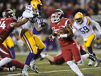 NWA Media/ANDY SHUPE - Arkansas' Korliss Marshall, right, carries the ball through the LSU defense during the first quarter Saturday, Nov. 15, 2014, at Razorback Stadium in Fayetteville.