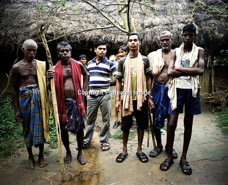 """Raghunath Das (left) and many other villagers take on the responsibility to guard the gate leading to their village Dingkhia in Orissa, India. These villagers have formed an agitating group, """"Posco Pratirdh Sangram Samiti"""" to oppose the construction of Posco port in their village."""
