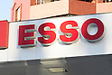 Esso signboard on display at its gas station in Tokyo, Japan on December 4, 2015. Japan's largest oil refiner and wholesaler JX Holdings Inc., which operates ENEOS gas stations, is continuing talks to finalize the acquisition of competitor TonenGeneral Sekiyu by the end of this year. The companies have combined sales of 14 trillion yen ($113 billion) and plan a share swap in the latest move towards consolidating their businesses by 2017. JX Holdings operates 14,000 ENEOS gas stations and TonenGeneral operates Esso, Mobil and General brand gas stations. Together they represent around 40% of all stations in Japan. (Photo by Rodrigo Reyes Marin/AFLO)