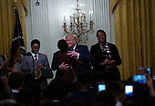 United States President Donald J. Trump embraces a woman after she led a prayer at the Young Black Leadership Summit in the East Room of the White House in Washington D.C., U.S. on October 4, 2019.<br />  <br /> Credit: Stefani Reynolds / CNP