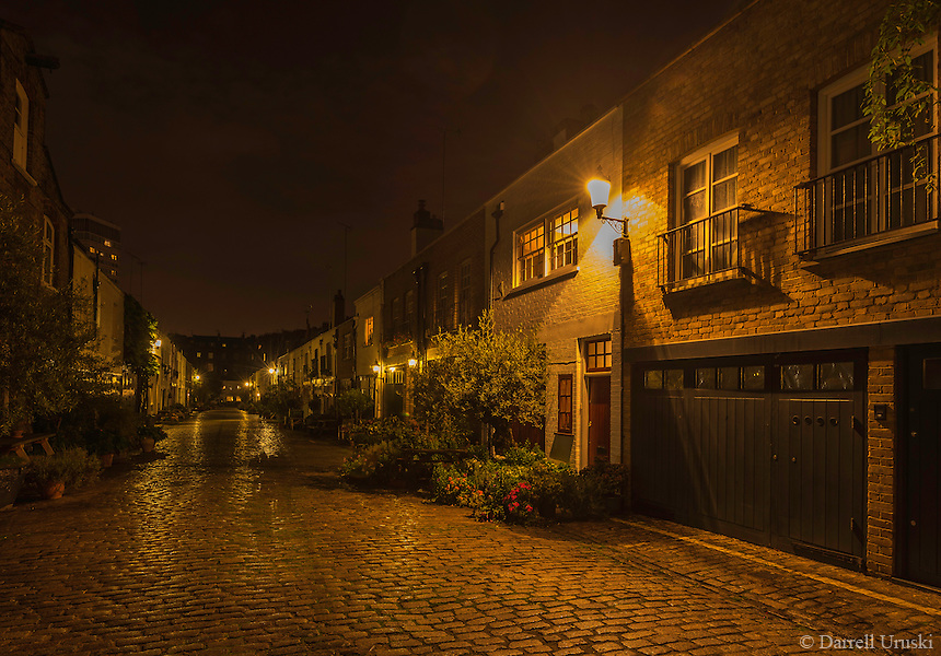 Night Scenic Street Scene Of A Cobblestone Street In
