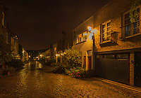 Night Scenic, street scene of a cobblestone street not far from Paddington Station, and Sussex Gardens in London England.<br />