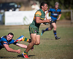 Kieran Whyte fails to stop the hard running Sione Fifita. Counties Manukau Premier Club Rugby game between Onewhero and Pukekohe, played at Onewhero, on Saturday April 05 2014. Onewhero won the game 28 - 23 after leading 17 - 15 at halftime.  Photo by Richard Spranger
