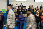 December 13, 2008. Erwin, North Carolina.. The troops leave the gym where the ceremony was held.. A deployment ceremony was held at Cape Fear Christian Academy for B Company 230th Brigade Support Battalion headquartered in Dunn, NC.. The unit is part of the North Carolina National Guard's 30th Heavy Brigade Combat Team, which has 4000 soldiers  deploying to Iraq in April after training. The 30th was last deployed to Iraq in 2003-2005.