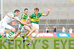 Jim O'Donovan fails to stop the advance of Donnchadh Walsh in the Muster Senior Semi final held in The Gaelic Grounds last Saturday evening.