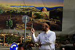 An Israeli settler photos for The head of the Roman Catholic Church in the Holy Land, the Latin Patriarch of Jerusalem Fuad Twal stops next to the separation wall between the West Bank town of Bethlehem and Jerusalem on his way to the Church of Nativity on 24 December 2009. Twal, a 69-year-old Jordanian who was appointed Latin Patriarch last year, is to lead the Midnight Mass at Bethlehem's early medieval Church of the Nativity, built according to Christian tradition on the site of the stable where Jesus was born. Photo by Issam Rimawi