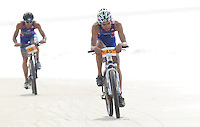 13 JUL 2013 - DEN HAAG, NED - Audric Lambolez (FRA) of France races along the beach on the bike during the 2013 ITU under 23 Men's Cross Triathlon World Championships in Kijkduin, Den Haag (The Hague), the Netherlands (PHOTO COPYRIGHT © 2013 NIGEL FARROW, ALL RIGHTS RESERVED)