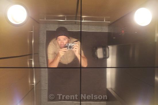 trent in mirror with fuji x100, in Salt Lake City, Utah, Monday, October 17, 2011.
