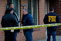 Police Officers and FBI members patrol the entrance of the building related to the shootings at Sandy Hook Elementary School, in Hoboken, United States. 14/12/2012. Photo by ZAMEK
