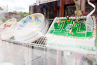 A cake shop window in New York City belies the city's preoccupation with the World Cup on June 9, 2006.  <br /> <br /> The World Cup, held every four years in different locales, is the world's pre-eminent sports tournament in the world's most popular sport, soccer (or football, as most of the world calls it).  Qualification for the World Cup is open to any country with a national team accredited by FIFA, world soccer's governing body. The first World Cup, organized by FIFA in response to the popularity of the first Olympic Games' soccer tournaments, was held in 1930 in Uruguay and was participated in by 13 nations.    <br /> <br /> As of 2010 there are 208 such teams.  The final field of the World Cup is narrowed down to 32 national teams in the three years preceding the tournament, with each region of the world allotted a specific number of spots.  <br /> <br /> The World Cup is the most widely regularly watched event in the world, with soccer teams being a source of national pride.  In most nations, the whole country is at a standstill when their team is playing in the tournament, everyone's eyes glued to their televisions or their ears to the radio, to see if their team will prevail.  While the United States in general is a conspicuous exception to the grip of World Cup fever there is one city that is a rather large exception to that rule.  In New York City, the most diverse city in a nation of immigrants, the melting pot that is America is on full display as fans of all nations gather in all possible venues to watch their teams and celebrate where they have come from.