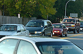 """Bowie, MD - October 23, 2002 -- Parents driving their kids to Benjamin Tasker Middle School create a traffic jam in the parking lot near one of the several main entrances. There were few students observed walking to school due to the fears surrounding the """"?Beltway Sniper"""".  Tasker is where an unidentified 13 year-old boy was shot on October 7, 2002.<br /> Credit: Ron Sachs / CNP<br /> (RESTRICTION: NO New York or New Jersey Newspapers or newspapers within a 75 mile radius of New York City)"""