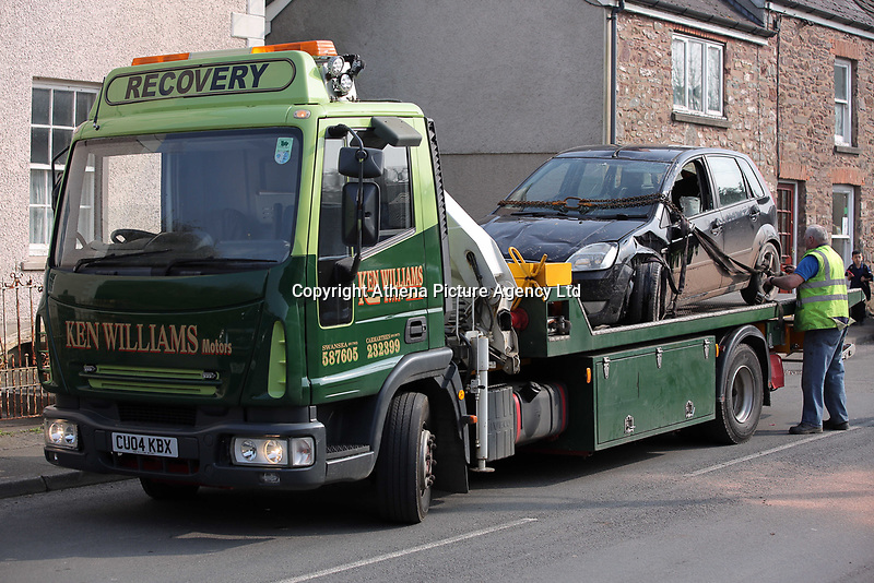 Pictured: The black Ford Fiesta is being recovered from Clifton Street in Laugharne, Carmarthenshire, Wales, UK. Monday 27 March 2017<br /> Re: An accident involving a black Ford Fiesta nad a Volvo car has blocked the main road through, Laugharne in Carmarthenshire.<br /> The A4066 Clifton Street in Laugharne has been closed in both directions because of the accident near the Memorial Hall.<br /> The incident has led to congestion between St Clears and Pendine.