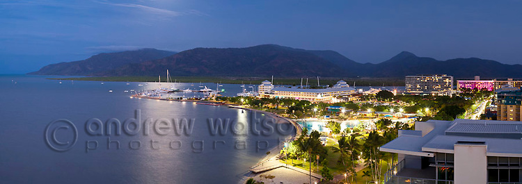 Cairns Esplanade and marina at dusk.  Cairns, Queensland, Australia