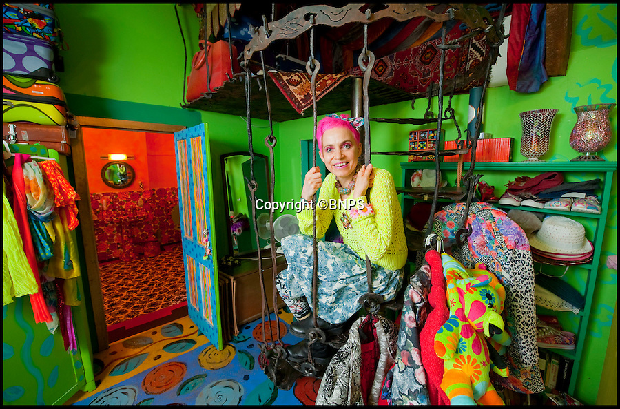 BNPS.co.uk (01202 558833)<br /> Pic: PhilYeomans/BNPS<br /> <br /> Artist Mary Rose Young.<br /> <br /> Britain's wackiest property has come on the market...And the estate agents mantra of paint everything magnolia has definately not been applied.<br /> <br /> It may look like an idyllic cottage in the Forest of Dean from the outside but ceramic artist Mary Rose Young's unique taste has transformed the interior into what looks like something from Alice in Wonderland.<br /> <br /> The three-bedroomed house is decorated from head to toe in crazy colours, clashing patterns, and enormous murals,<br /> each room is covered in the garish designs, including the bathroom, where even the sink and toilet have been adorned in bright tiles.<br /> <br /> Estate agents Bidmead Cook now have the tricky task of showing prospective punters round the £500,000 property.