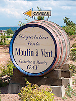 France, FRA, Département Rhone, Beaujolais, Romanèche-Thorins, 2009Jul23: A winery advertises their Beaujolais wine of Moulin à Vent using a wine barrel.