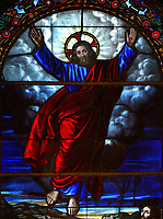 Christ ascending to heaven, detail from the stained glass window behind the altar in the Cathedrale de la Sainte Trinite, or Holy Trinity Cathedral, an Anglican cathedral built 1800-04 by William Robe and William Hall, in Quebec City, Quebec, Canada. The window is dedicated to the memory of the 3rd bishop George Jehoshaphat Mountain, and was made in London in 1864 by the Clutterbuck firm. The cathedral is listed as a National Historic Site of Canada, and the Historic District of Old Quebec is listed as a UNESCO World Heritage Site. Picture by Manuel Cohen