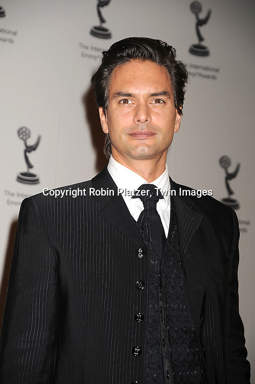 0834 marcus schenkenbergg robin platzertwin images marcus schenkenbergposing for photographers at the 36th annual international emmy awards on november thecheapjerseys Gallery