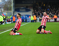 Lincoln City's Kellan Gordon celebrates scoring the opening goal with with team-mate Neal Eardley<br /> <br /> Photographer Andrew Vaughan/CameraSport<br /> <br /> The EFL Sky Bet League Two - Lincoln City v Mansfield Town - Saturday 24th November 2018 - Sincil Bank - Lincoln<br /> <br /> World Copyright &copy; 2018 CameraSport. All rights reserved. 43 Linden Ave. Countesthorpe. Leicester. England. LE8 5PG - Tel: +44 (0) 116 277 4147 - admin@camerasport.com - www.camerasport.com