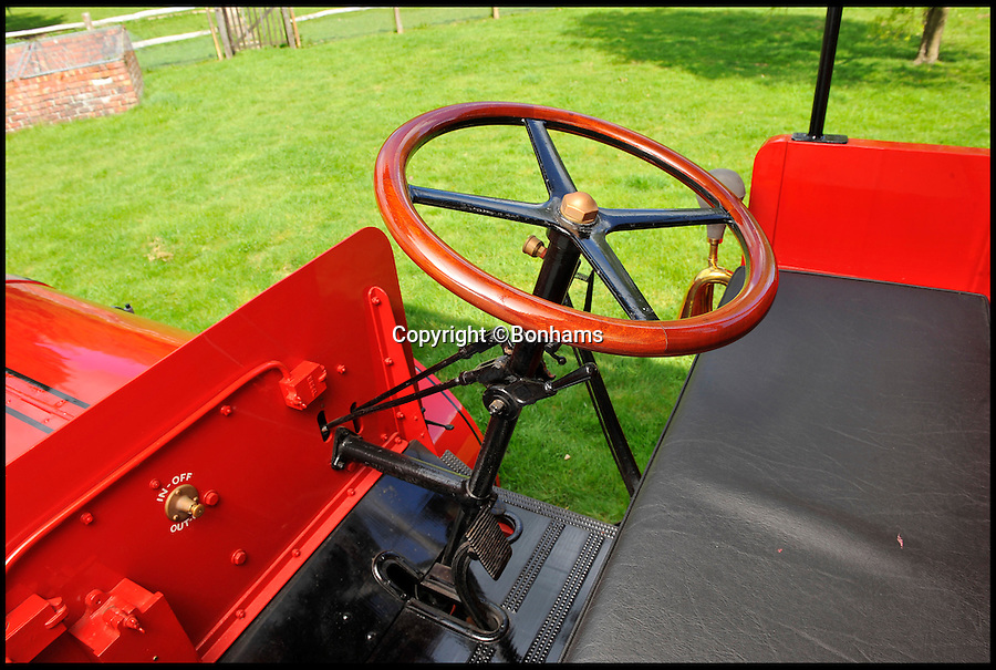 BNPS.co.uk (01202 558833)<br /> Pic: Bonhams/BNPS<br /> <br /> ***Please use full byline***<br /> <br /> Two pedal simplicity for drivers more used to horses.<br /> <br /> Just the ticket -  1920's 'Boris Bus' sells for twice its estimate.<br /> <br /> A last surviving petrol electric hybrid London bus from the 1920's has revealed that Eco technology has been around for a lot longer than most people think.<br /> <br /> The world's first environmentally friendly bus, that was built almost 100 years ago, has sold for &pound;216,000<br /> <br /> The vintage vehicle uses similar technology to the Boris bus in London today, except it was actually made in 1922.<br /> <br /> The bright red double decker has a petrol engine which charges up the electric motor that then powers the bus.<br /> <br /> It is far more eco-friendly than an average petrol automobile of the time, because it constantly ran on the electric without the need to increase revs.<br /> <br /> A journey would have cost customers between one and two pennies each for an off-peak trip in the middle of the day.<br /> <br /> The rare bus was created by Tilling-Stevens and is one of the last surviving vehicles with solid tyres and the only one of its kind in existance today.<br /> <br /> This bus was discovered in a scrap yard by Michael Banfield, a car and coach enthusiast, and he spent many years restoring it to its former glory before his death last year.<br /> <br /> It has now been auctioned at a Bonhams sale in Maidstone, Kent.