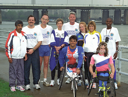 United States President Bill Clinton poses for a group photo with winners of the Boston Marathon following an early morning jog in Washington, D.C. on April 19, 1995..Credit: Ron Sachs / CNP