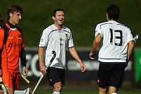 7c96115740c Auckland s Phil Burrows congratulates Simon Child on his goal. Auckland v  Midlands men s semifinal of
