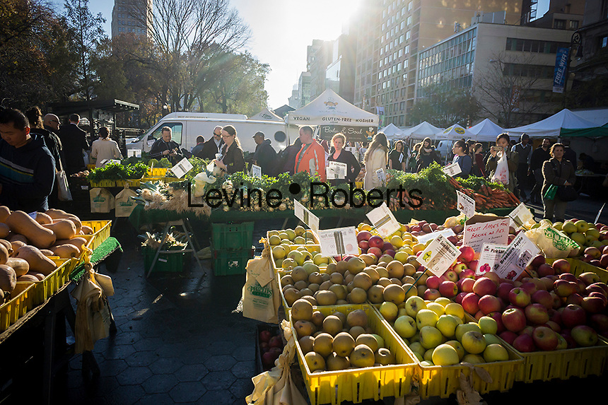 Shoppers a farm stand at the Union Square Greenmarket in New York on Monday, November 24, 2014.   (© Richard B. Levine)