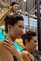 """Models show off diamond rings for sale at the """"Top Show"""" luxury gods fair in Shenzhen, China."""