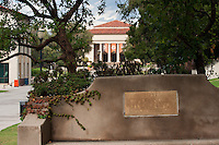 """View of the campus, featuring a bench that reads, """"1937 Quandrangle Landscaping Gift of A.E. Bell '95"""" with Thorne Hall visible behind, Occidental College, Friday, October 1, 2010. (Photo by Marc Campos, Occidental College Photographer)"""