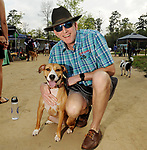Dog owners enjoy the Saint Arnold's 4th Annual Pup Crawl at the Houston Arboretum and Nature Center Sunday March 10,2019.  (Dave Rossman Photo)