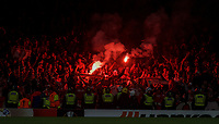 The lively FC Koln crowd behind a row of Police during the UEFA Europa League match between Arsenal and FC Koln at the Emirates Stadium, London, England on 14 September 2017. Photo by Andrew Aleks.