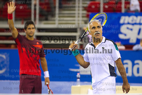 Mansour Bahrami (R) from Iran plays an exhibition duo match together with Fernando Verdasco (L) from Spain against Gael Monfils (not pictured) and Fabrice Santoro (not pictured) from France during the Tennis Classics tournament in Budapest, Hungary on October 29, 2011. ATTILA VOLGYI