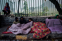 OLD DELHI, INDIA, JANUARY 11, 2016: MenBoys sit undert a rented blanket, on the roadsidenear to a sleep market on January 11, 2016 in Old Delhi, India. <br /> Daniel Berehulak for The New York Times