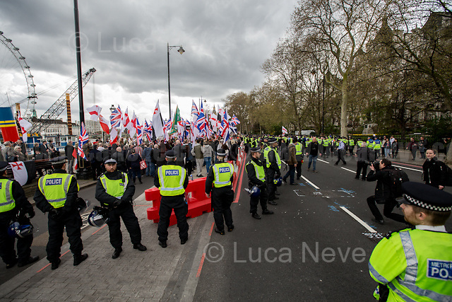 (On the L) Britain First, (On the R) EDL.<br /> <br /> London, 01/04/2016. Today, two British far-right extremist groups, Britain First and the EDL (English Defence League), held two separate marches and rallies in reaction to the recent Westminster terror attack in a 'designated area' between Trafalgar Square, Whitehall and Victoria Embankment. A counter-demonstration was called by the Anti-Fascist Network, London Antifascists and Unite Against Fascism (UAF) to oppose the extremist right-wing racist rhetoric and exploitation of the attack by attributing responsibility to Muslim communities and migrants. A heavy riot police presence (with the aid of a helicopter, police horses and dogs) was in the area trying to keep the three factions separated: the EDL in a Whitehall pub and Britain First moved directly to the Embankment. The situation for the anti-fascist groups was different, while they were trying to march from Trafalgar Square to their designated area in Embankment close to the Ministry of Defence HQ, police imposed Section 14 (As explained in a Police information leaflet called: &quot;Police Information UAF Protest&quot; - see IMG_4859), arresting and taking away several left-wing activists. The anti-fascist rally was decimated by this police tactic, leaving a very small counter rally to confront the two extreme right-wing groups. <br /> <br /> To read Section 14 - Public Order Act 1986 please read the PDF attached at the end of this story or click here: http://www.legislation.gov.uk/ukpga/1986/64