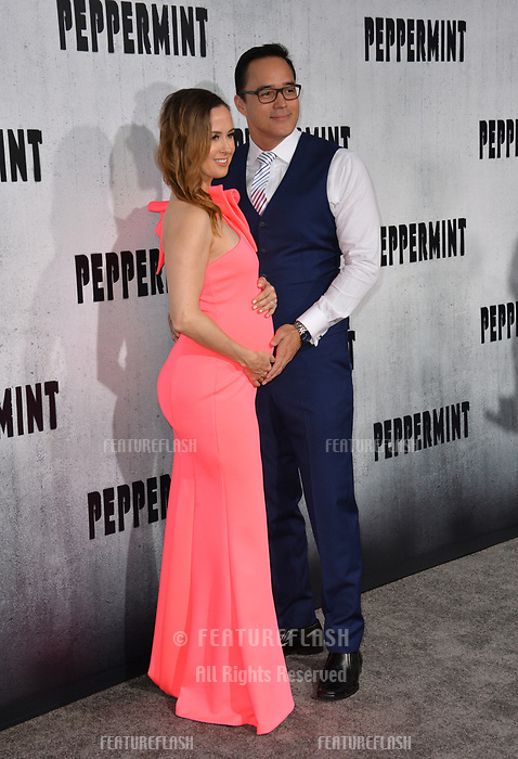 "LOS ANGELES, CA. August 28, 2018: Erin Carufel & Scott Connors at the world premiere of ""Peppermint"" at the Regal LA Live."