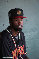 Wes Rogers (24) of the Modesto Nuts sits in the dugout before a game against the Lancaster JetHawks at The Hanger on June 7, 2016 in Lancaster, California. Lancaster defeated Modesto, 3-2. (Larry Goren/Four Seam Images)