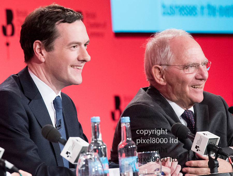 Pix shows: British Chambers of Commerce<br /> QEII Centre London. Dr Woflgang Schauble  - German Finance Minister<br /> <br /> George Osborne and Dr Woflgang Schauble  - German Finance Minister - smile and joke through questions.<br /> <br /> Schauble said Germany 'would cry' if Britain left Europe.<br /> <br /> <br /> <br /> <br /> Pic by Gavin Rodgers/Pixel 8000 Ltd