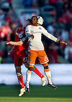 07 May 2011: Houston Dynamo midfielder Lovel Palmer #22 and Toronto FC midfielder Jacob Peterson #23 in action during an MLS game between the Houston Dynamo and the Toronto FC at BMO Field in Toronto, Ontario..Toronto FC won 2-1.