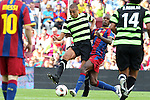 Football -Barcelona's Erick Abidal and Trezguet of Hercules during Barcelona vs Hercules match at Camp Nou stadium in Barcelona, September 11, 2010.