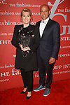 Marie-Claire Daveu receives the Sustainability award and poses with surfer Kelly Slater, at The Fashion Group International's Night of Stars 2017 gala at Cipriani Wall Street on October 26, 2017.
