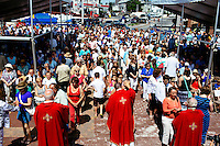 Worshippers take communion during Sunday Mass in St. Peter's Square during St. Peter's Fiesta in Gloucester, Massachusetts, USA.