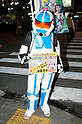 "July 23 2012, Tokyo, Japan - A man wears as a soldier of the Star Wars movie holds up a sign announcing the ""Robot Restaurant"" at Kabukicho in Shinjuku. The restaurant advertises that cost 10 billion yen (130 million) opening. Robots run by real women dressed in military, perform cabaret dance for its customers, opened in the Kabukicho area, Shinjuku in Tokyo. (Photo by Rodrigo Reyes Marin/AFLO)"