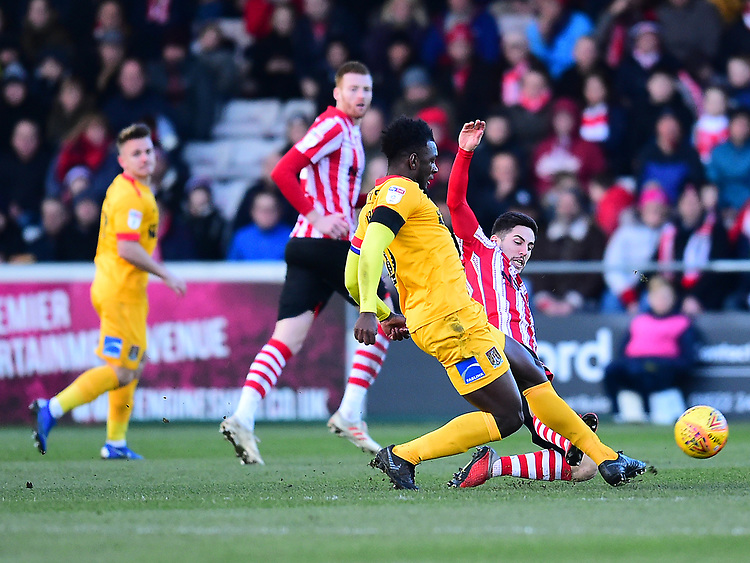 Northampton Town's Aaron Pierre is tackled by Tom Pett<br /> <br /> Photographer Andrew Vaughan/CameraSport<br /> <br /> The EFL Sky Bet League Two - Lincoln City v Northampton Town - Saturday 9th February 2019 - Sincil Bank - Lincoln<br /> <br /> World Copyright © 2019 CameraSport. All rights reserved. 43 Linden Ave. Countesthorpe. Leicester. England. LE8 5PG - Tel: +44 (0) 116 277 4147 - admin@camerasport.com - www.camerasport.com