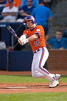 Kyle Parker #25 of the Clemson Tigers follows through on his swing versus the Duke Blue Devils at Durham Bulls Athletic Park May 22, 2009 in Durham, North Carolina.  (Photo by Brian Westerholt / Four Seam Images)