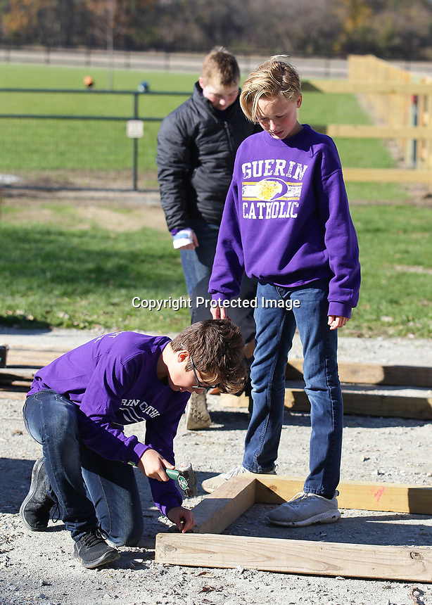 Jonathan Eleftheri and Sam Dunlap work on a project at Journey Farm near Sheridan.