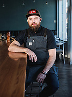 Executive Chef and Owner of Se&ntilde;or Bear Blake Edmunds at the restaurant in Denver, Colorado, December 18, 2017. Dishes photographed include Agua Chile, El Guise, Crispy Pig Tail, El Pollo Bronco, and a Parcha de mi vida cocktail made by bar manager Nate Maston.<br /> <br /> Photo by Matt Nager