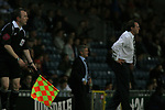 Blackburn Rovers 3, Huddersfield Town 1, 22/09/2005. Ewood Park, Carling Cup. Town manager Peter Jackson (right), his Blackburn counterpart Mark Hughes and the assistant referee all engrossed in the second half action. Photo by Colin McPherson.