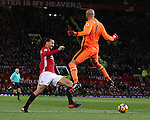 Zlatan Ibrahimovic of Manchester United knocks the ball past Darren Randolph of West Ham United only for it to roll to a defender during the Premier League match at the Old Trafford Stadium, Manchester. Picture date: November 27th, 2016. Pic Simon Bellis/Sportimage