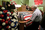 August 25, 2007. Kinston, NC.. A viewing of the coffin of Spc. Steven R. Jewell was held at Howard and Carter Funeral Home i Kinston, NC. Spc. Steven R. Jewell was killed in a helicopter crash  near the Iraqi city of Fallujah on August 14, 2007.. Jack Wisener, Spc. Jewell's stepfather, lays a hand on the coffin of his stepson.. .